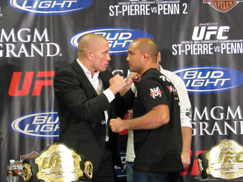 Welterweight champion Georges St-Pierre (l) faces off with lightweight champion BJ Penn